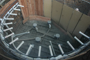 outdoor spa construction phase steel and plumbing rough in