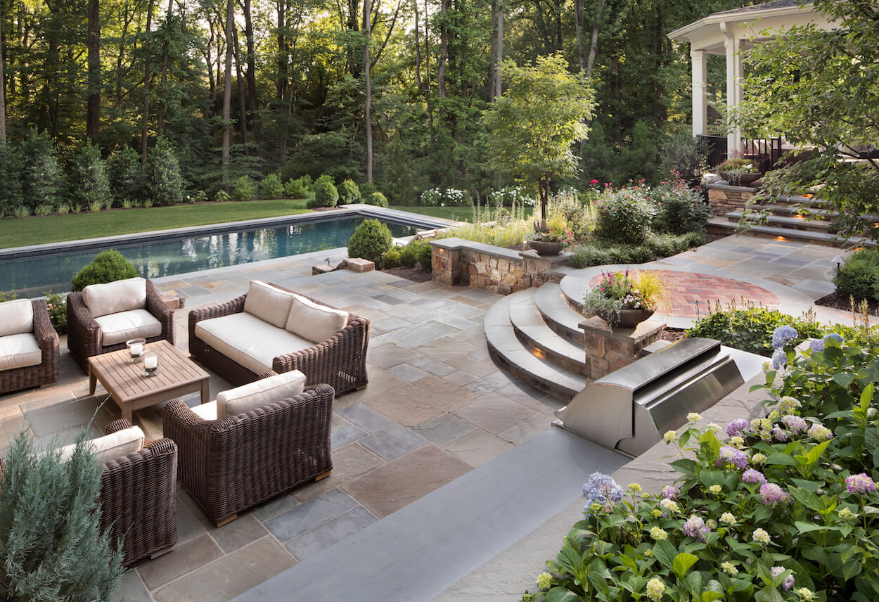 Should you use flagstone or pavers in your backyard patio Flagstone pavers around pool
