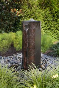 bubbler fountain of rough hewn basalt