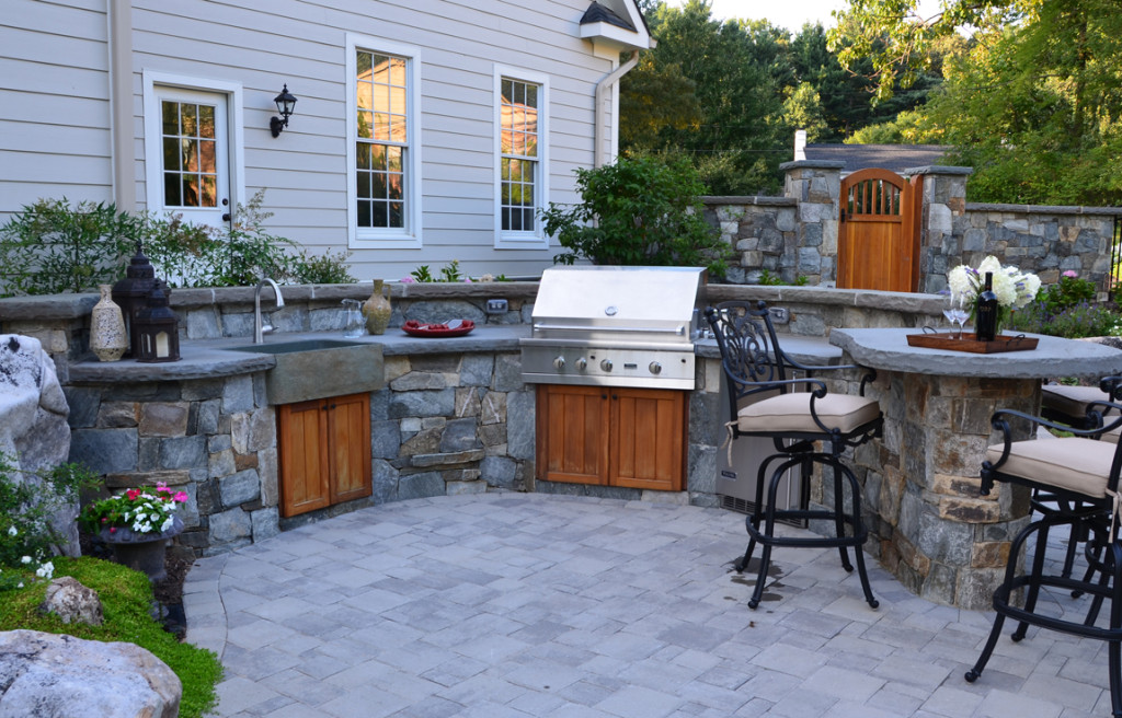 open air outdoor kitchen with stone farm house sink