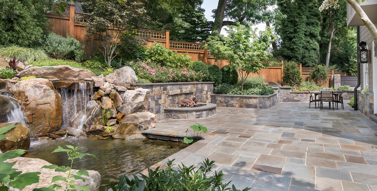 waterfall and koi pond in private backyard