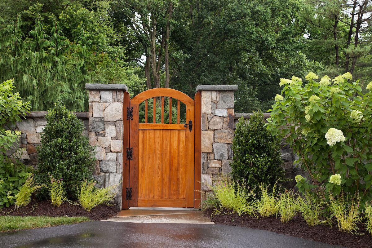 garden gate of redwood and stone