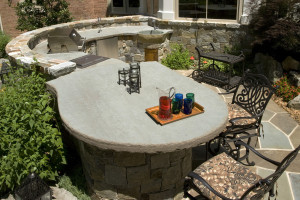 outdoor kitchen with massive stone slab countertop