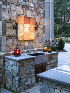 outdoor kitchen with carved stone farm house style sink
