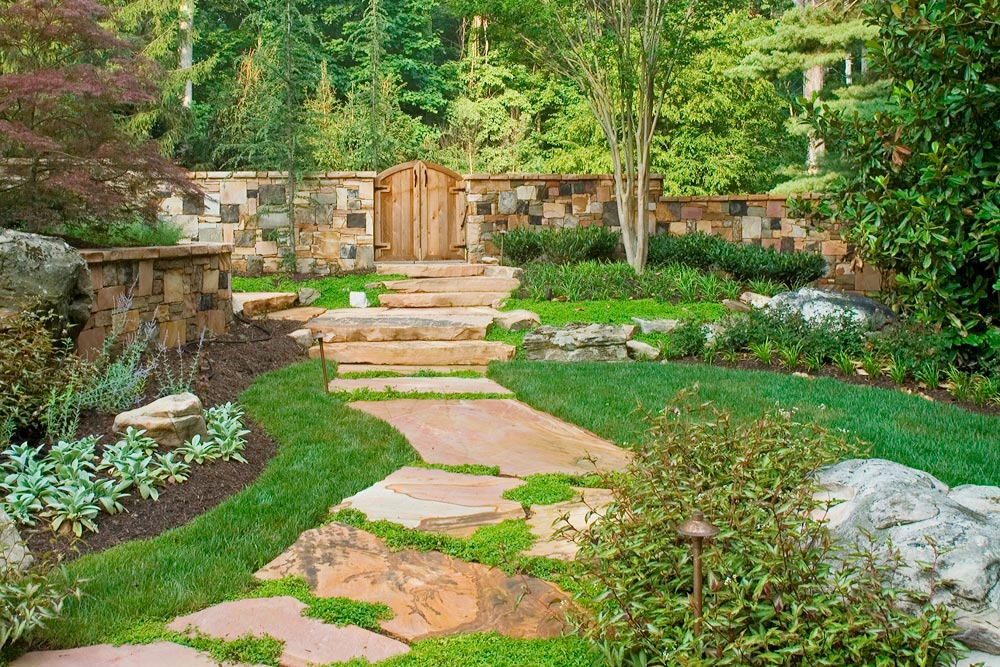 Outdoor fire pit lagoon style pool and infinity edge spa for Garden spas pool germantown tn