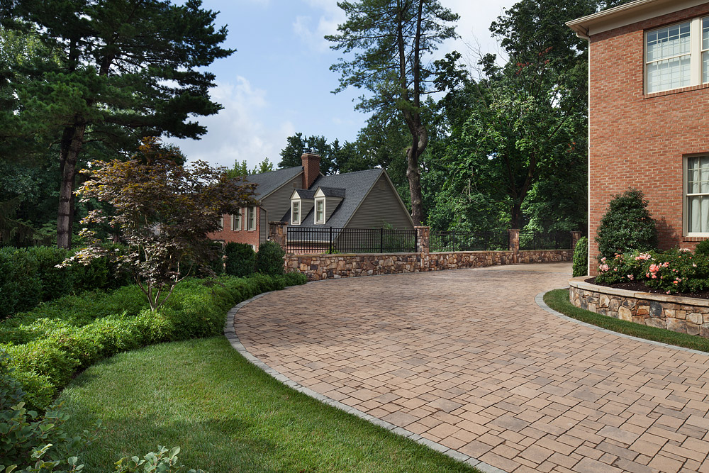 New curved driveway, privacy wall and iron works, plantings