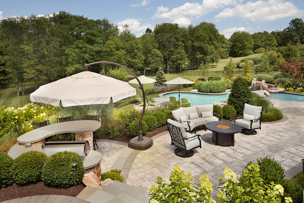 Backyard grill, bar, seating area and pools