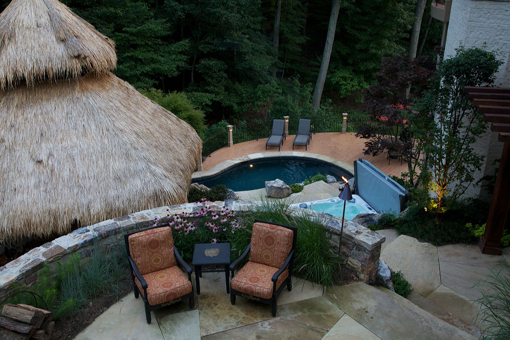 N-thatched-roof-flagstone-patio-stone-walls-wood-trellis