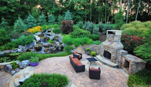 patio with waterfall and outdoor fireplace