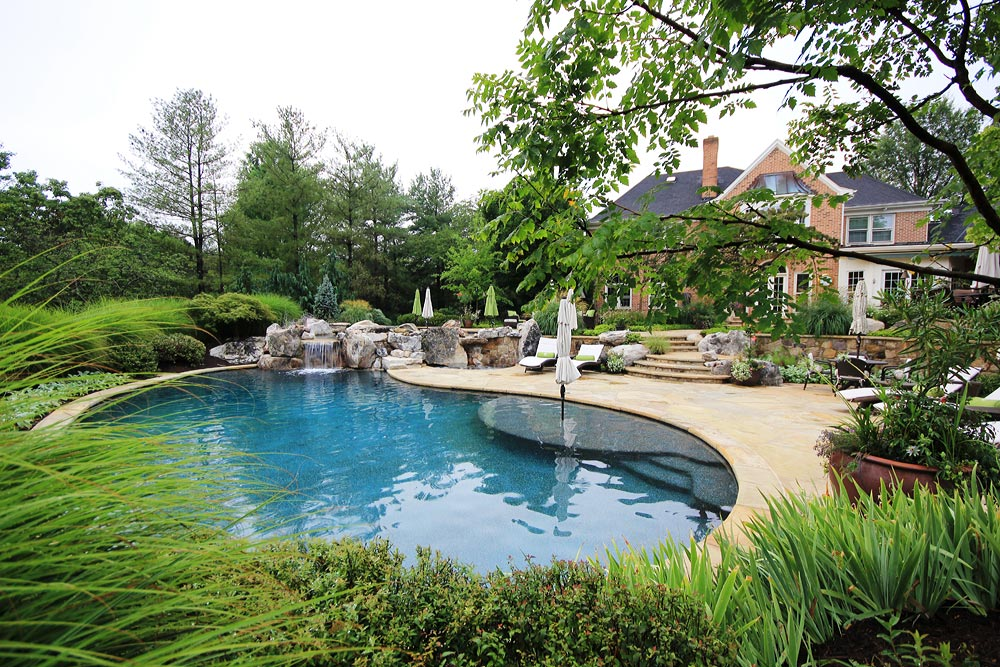 Photo gallery of swimming pools ponds fountains for Pond swimming pool