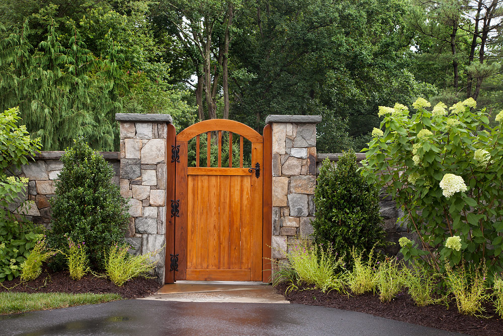 Stone walk and custom wooden gate
