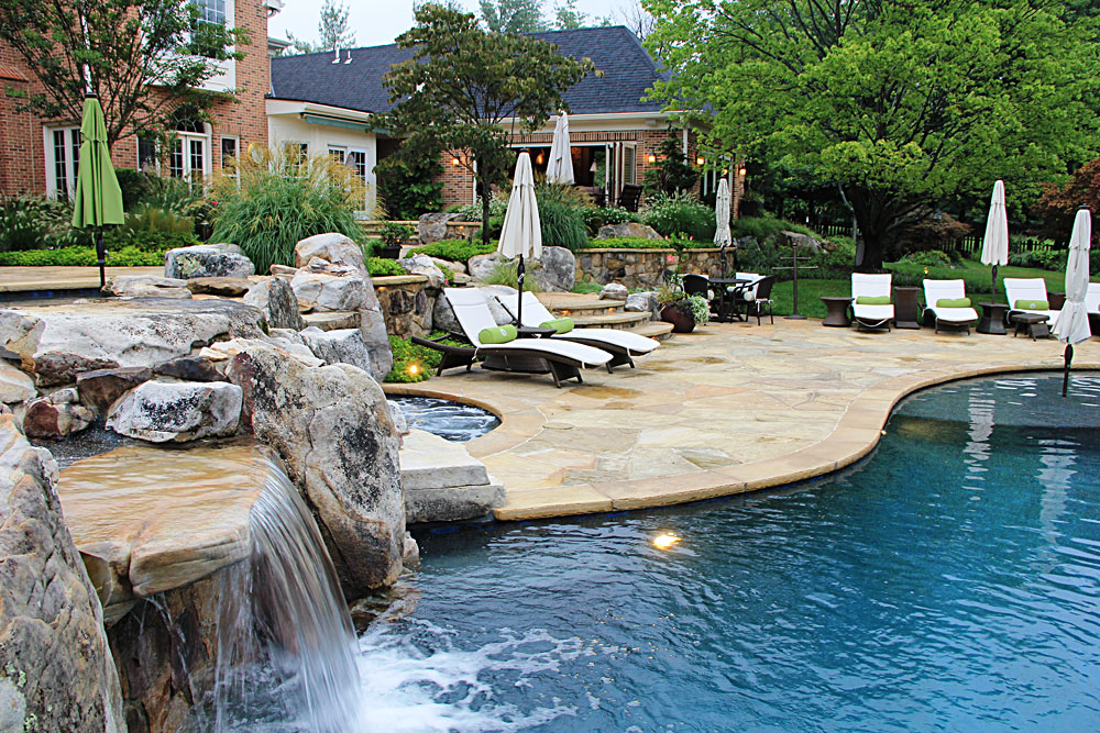 Flagstone and boulder terraces pool house outdoor lighting for Garden spas pool germantown tn