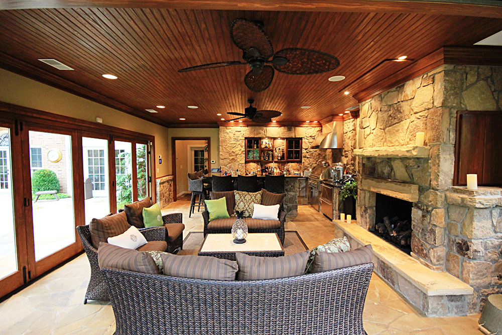 TH8-pool-house-addition-stone-gas-fireplace-bar-living-room