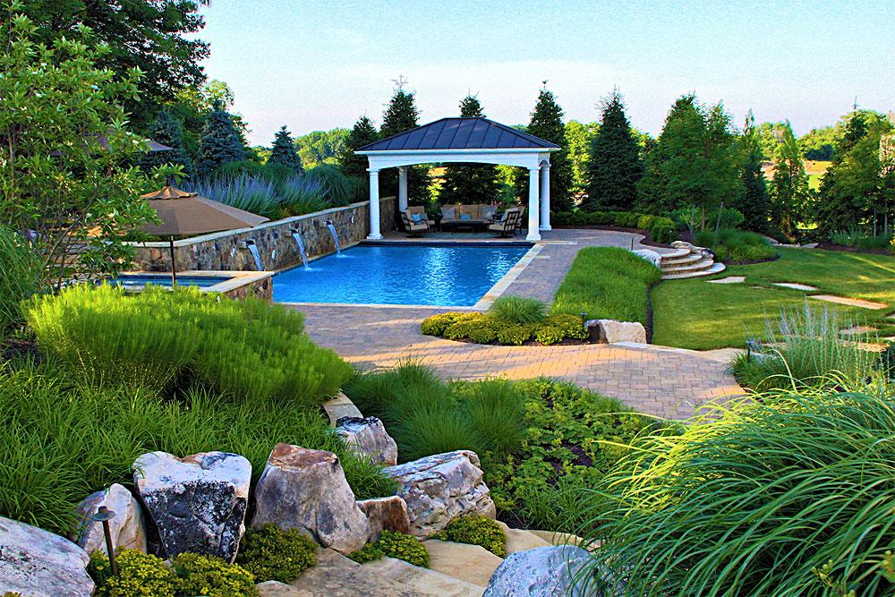 WIL8-flatstone-slab-steps-lush-grasses-pool-pavilion