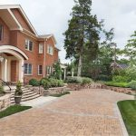 low retaining walls frame home entry and define driveway edges