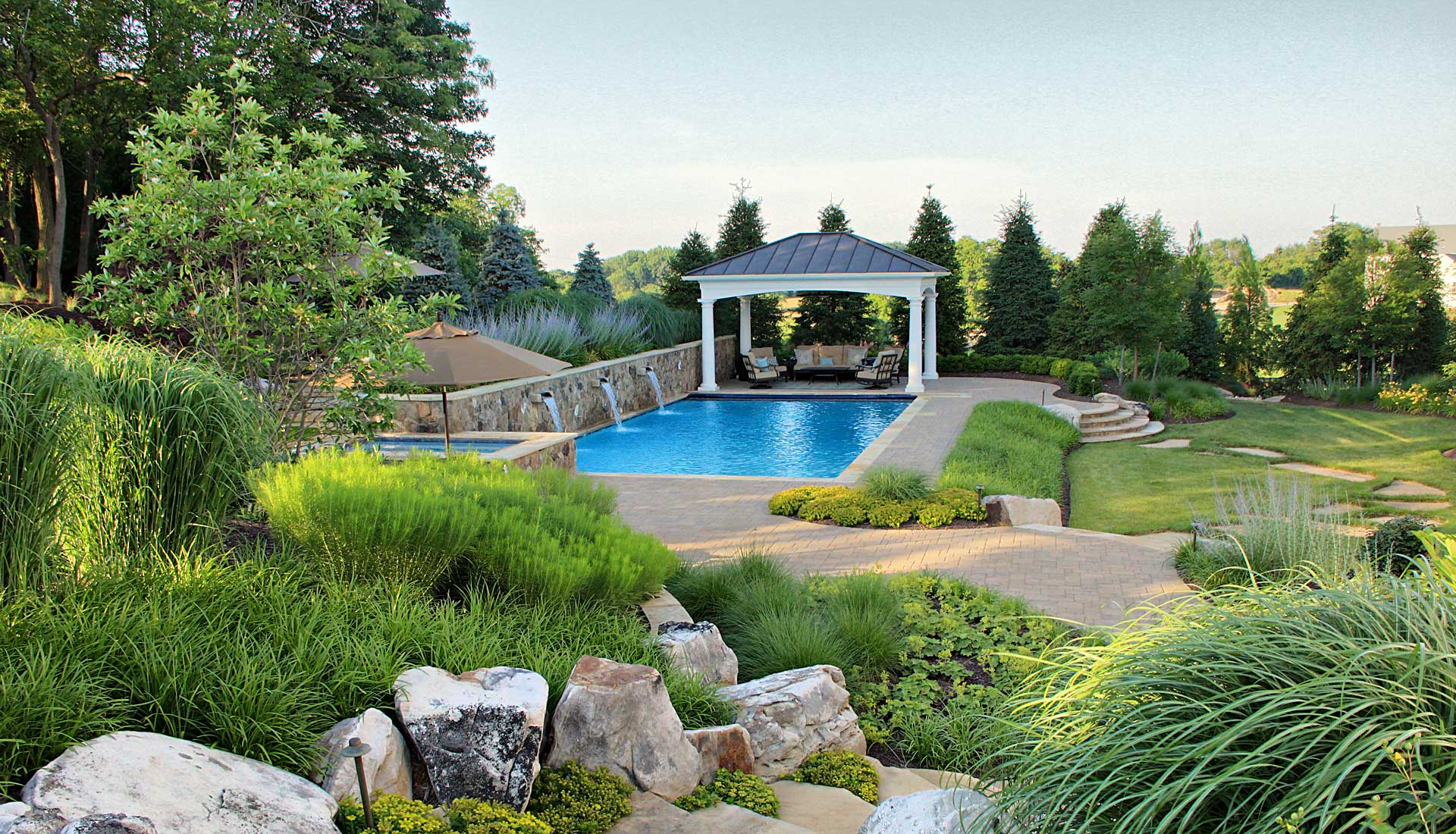 Boulders, steps and beautifully landscaped pool