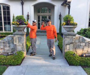 garden maintenance crew tends container plants