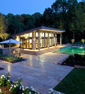 Modern pool house of glass and stone