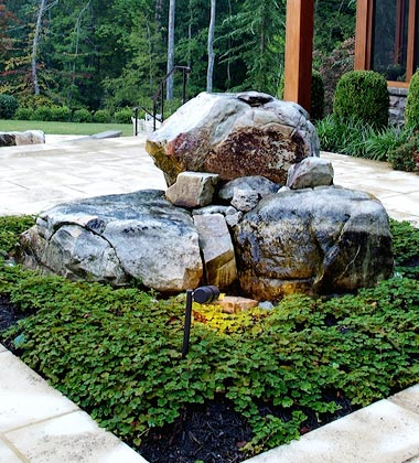 Naturalistic boulder water fountain