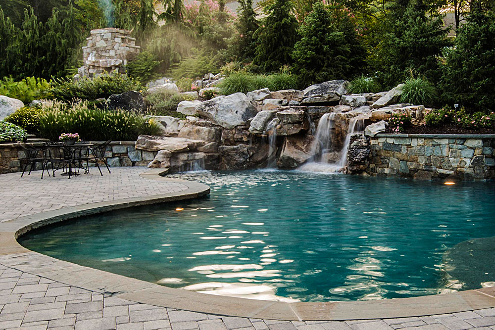 naturalistic backyard waterfalls feeding pond style swimming pool