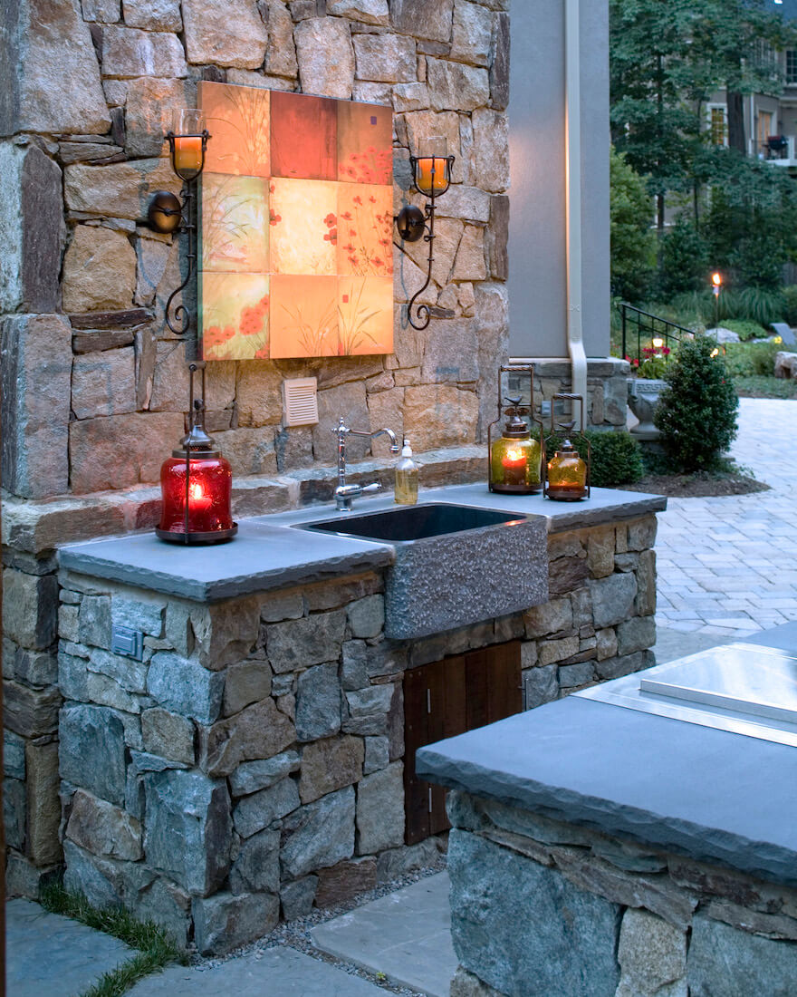 outdoor Kitchen accent lighting over farm style sink