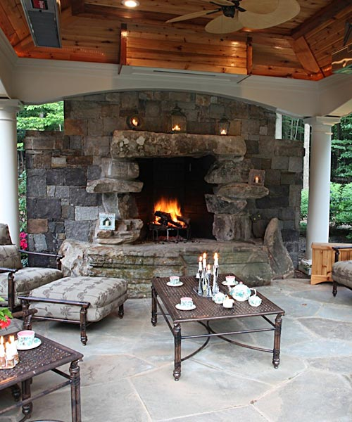 Outdoor fireplace in covered cabana
