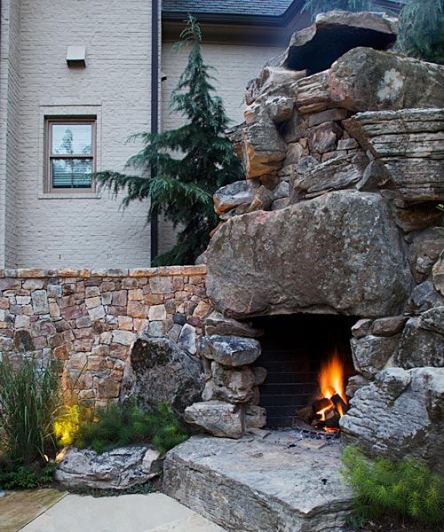 Rustic outdoor fireplace with gigantic boulders