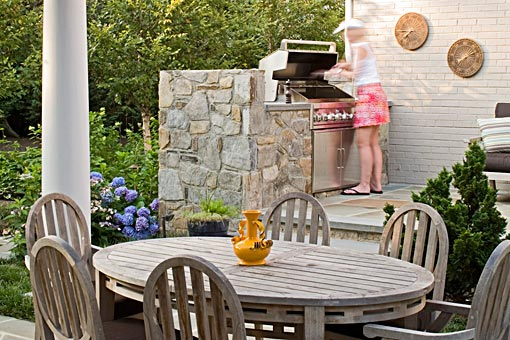 Outdoor kitchen with built in grill station