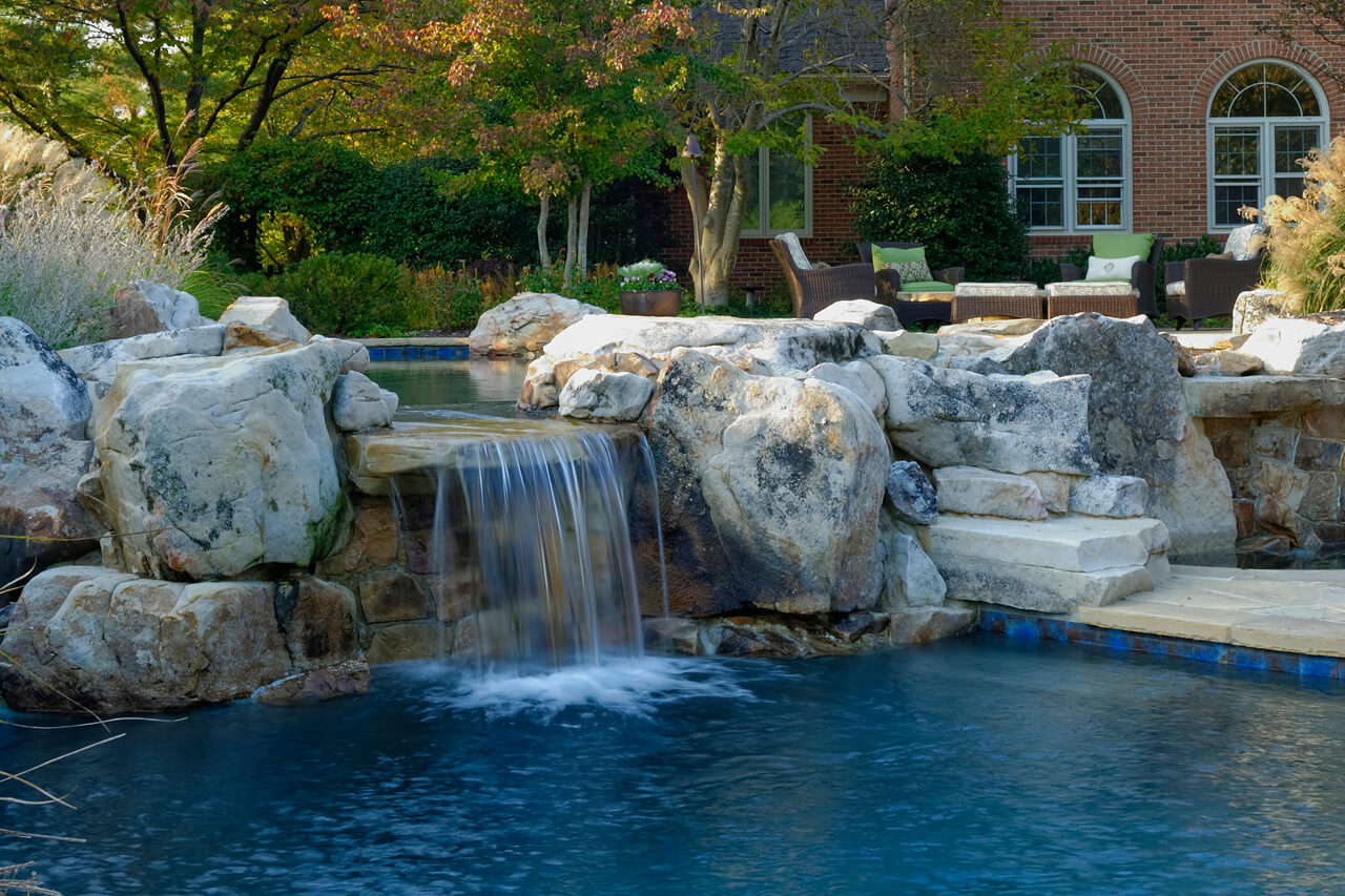 waterfall connecting spa and pool