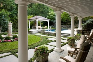 Outdoor porch and formal garden overlooking pool