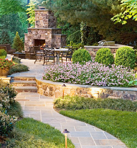 Curved walkway, retaining walls, outdoor kitchen and fireplace