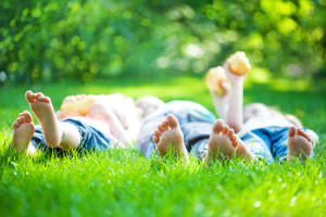kids laying on lawn